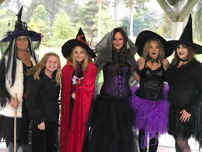 Witches Alicia Schian (from left) Grace Abbott, Izabell Rojas, Kristina Rojas, Amy McCallum and Samantha Fifield before the dance gets started.