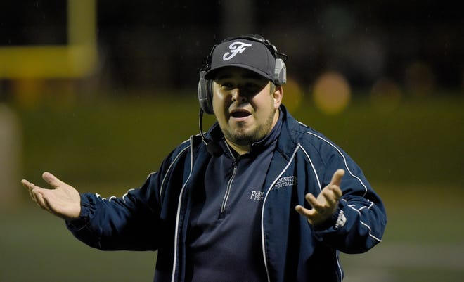 Farmington head coach Kory Cioroch doesn't understand a call by the officials during the OAA Blue Division championship game won by Seaholm 21-0.