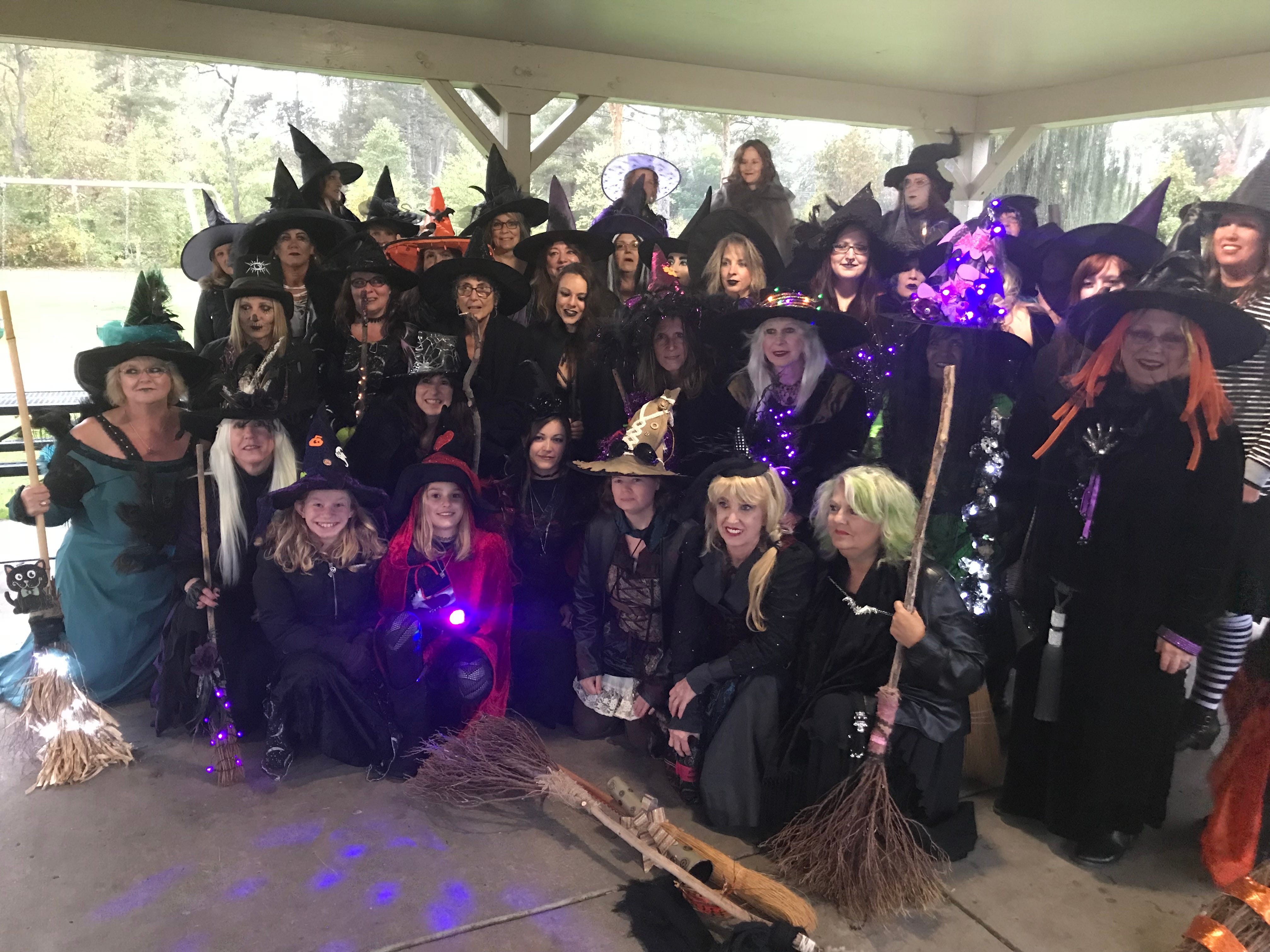 The witches brew up a group photo before the walk gets started.