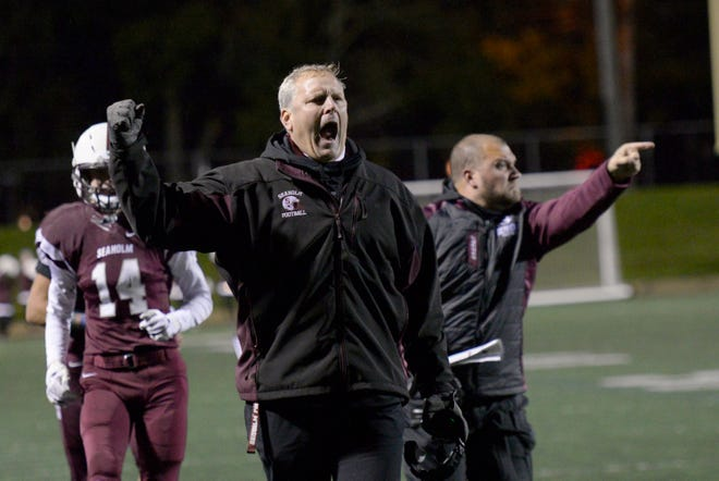 Seaholm head coach Jim DeWald is fired up as his team takes a 14-0 lead in the OAA Blue Division championship game won by the Maples 21-0 over Farmington.