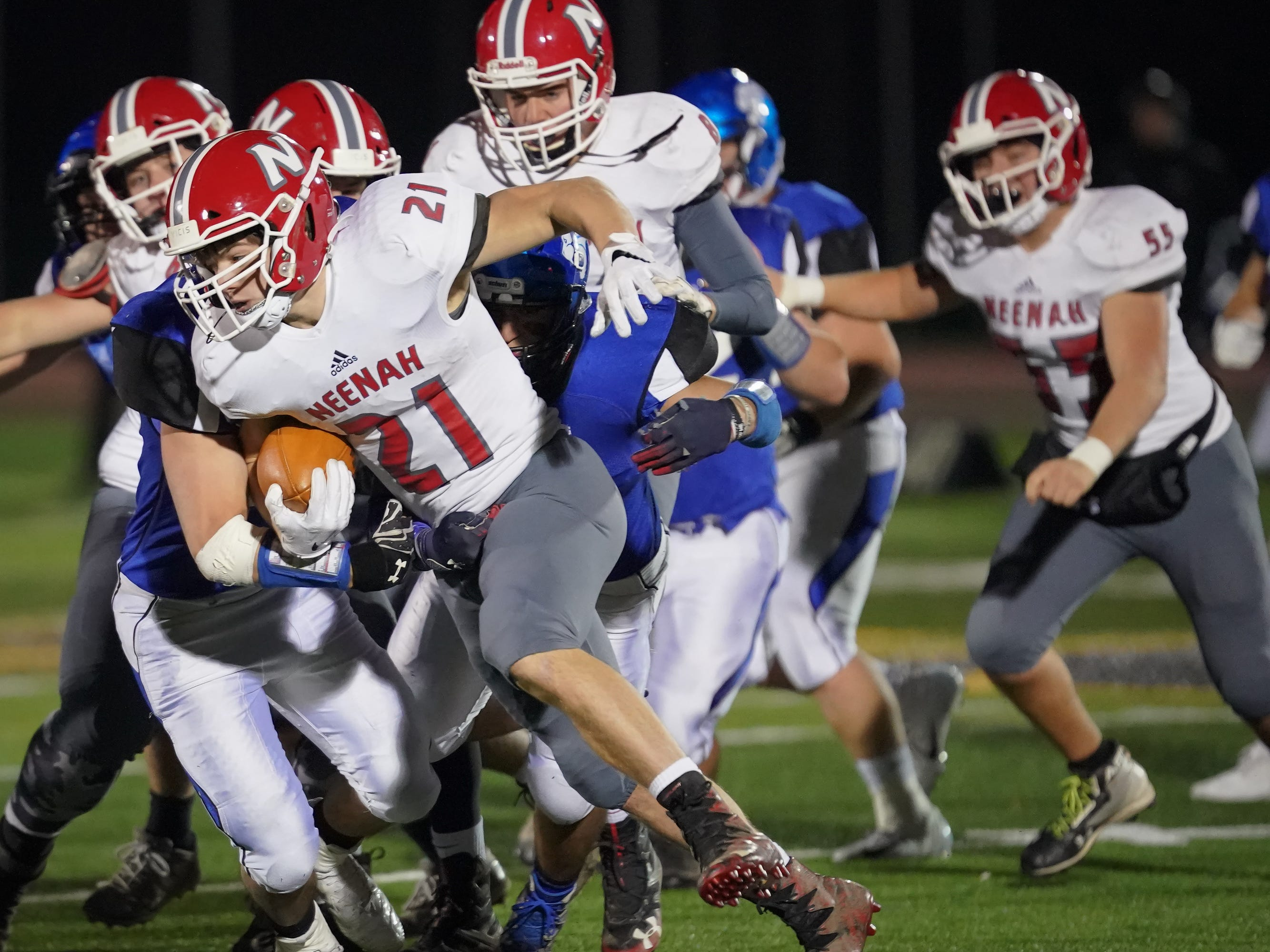 Carson Hughes (21) of Neenah looks for running room. The Oshkosh West Wildcats hosted the Neenah Rockets in an FVA-South conference matchup Friday evening, October 12, 2018 at J. J. Keller Field at Titan Stadium.