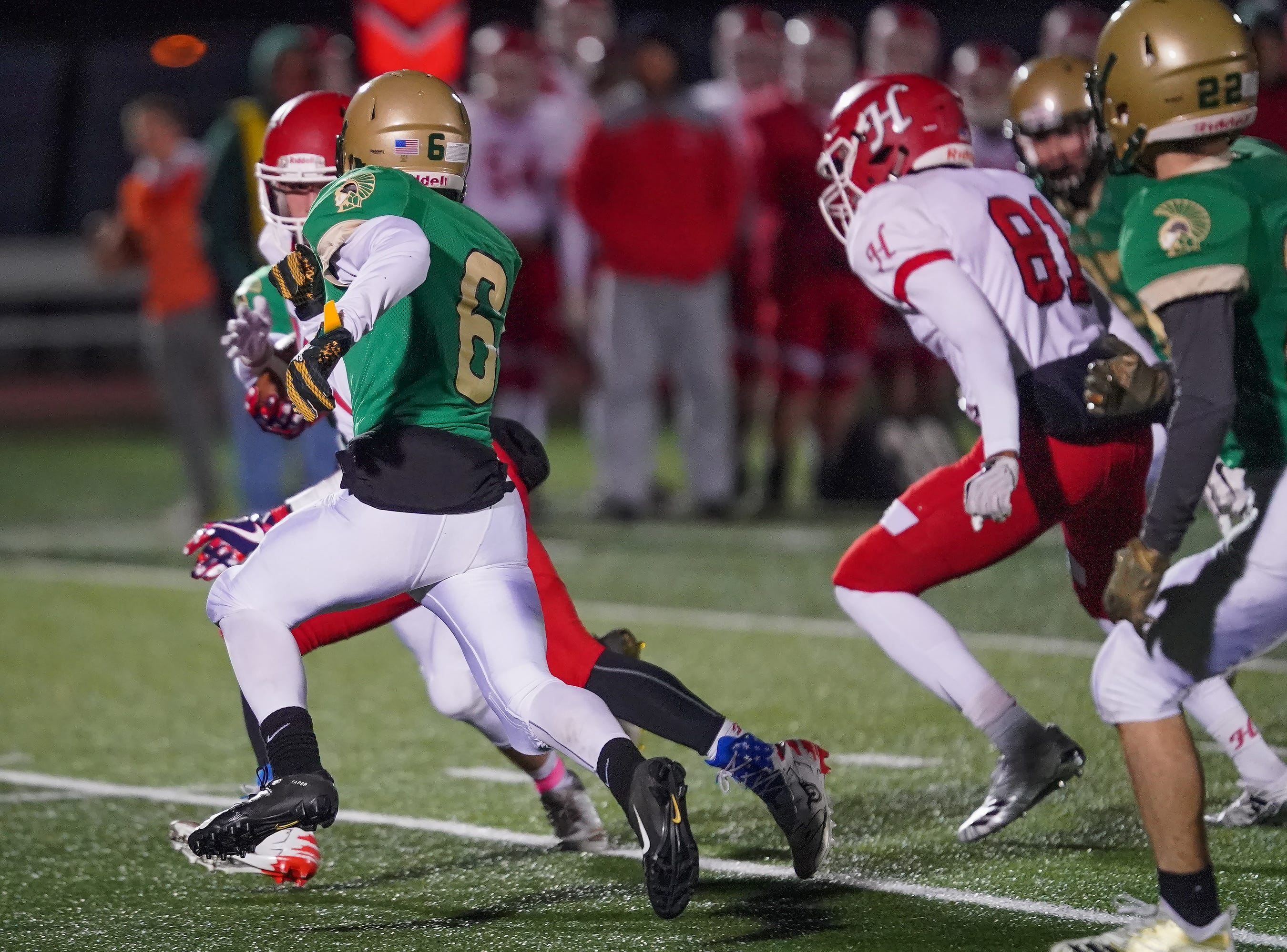 Braden Christie (6) of Oshkosh North looks for room to run during a punt return. The Oshkosh North Spartans hosted the Hortonville Polar Bears in an FVA-South conference matchup Friday evening, October 12, 2018 at J. J. Keller Field at Titan Stadium.