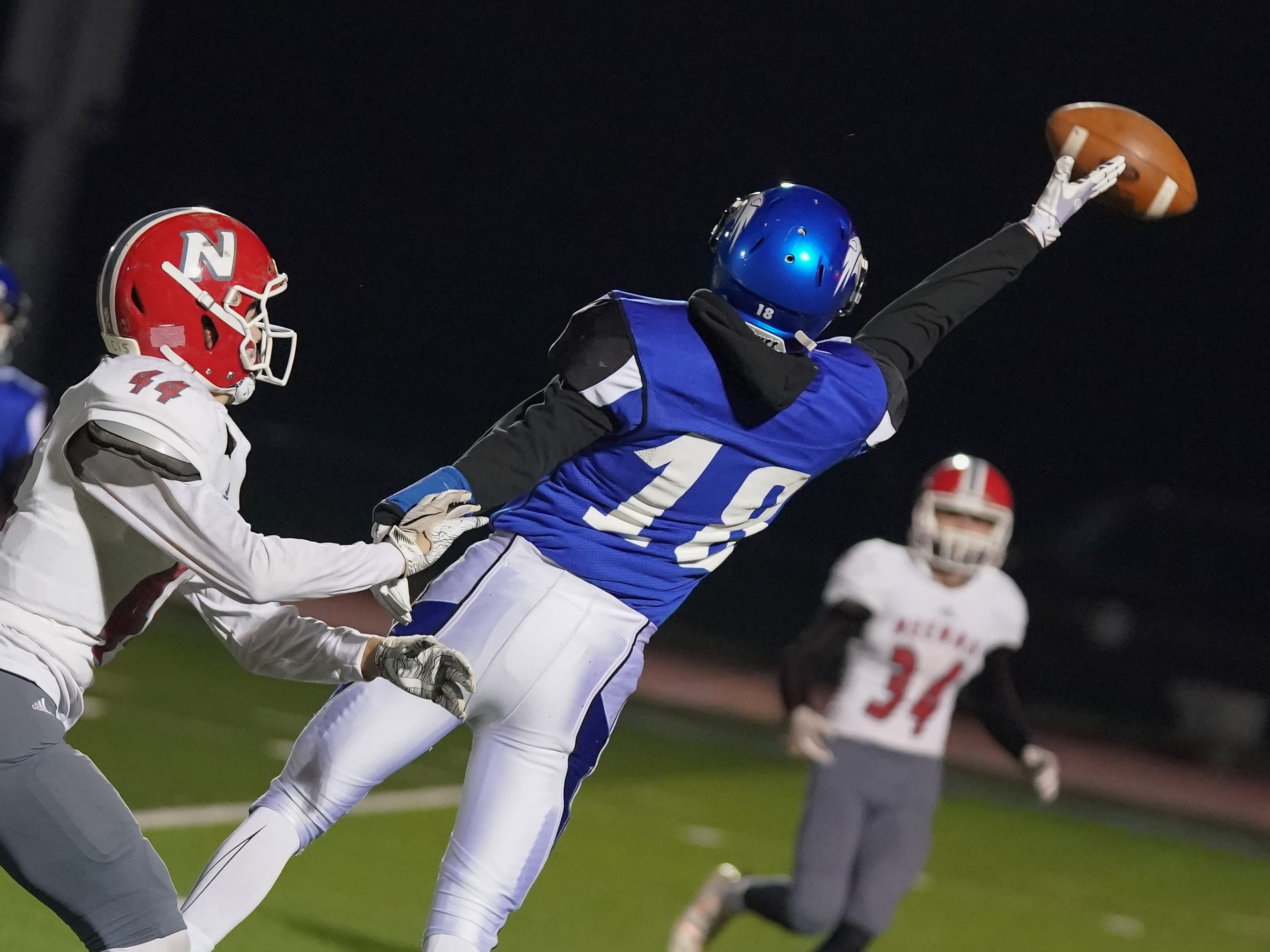 A.J. Ambroso (18) of Oshkosh West can't hang on to a pass near the end zone. The Oshkosh West Wildcats hosted the Neenah Rockets in an FVA-South conference matchup Friday evening, October 12, 2018 at J. J. Keller Field at Titan Stadium.