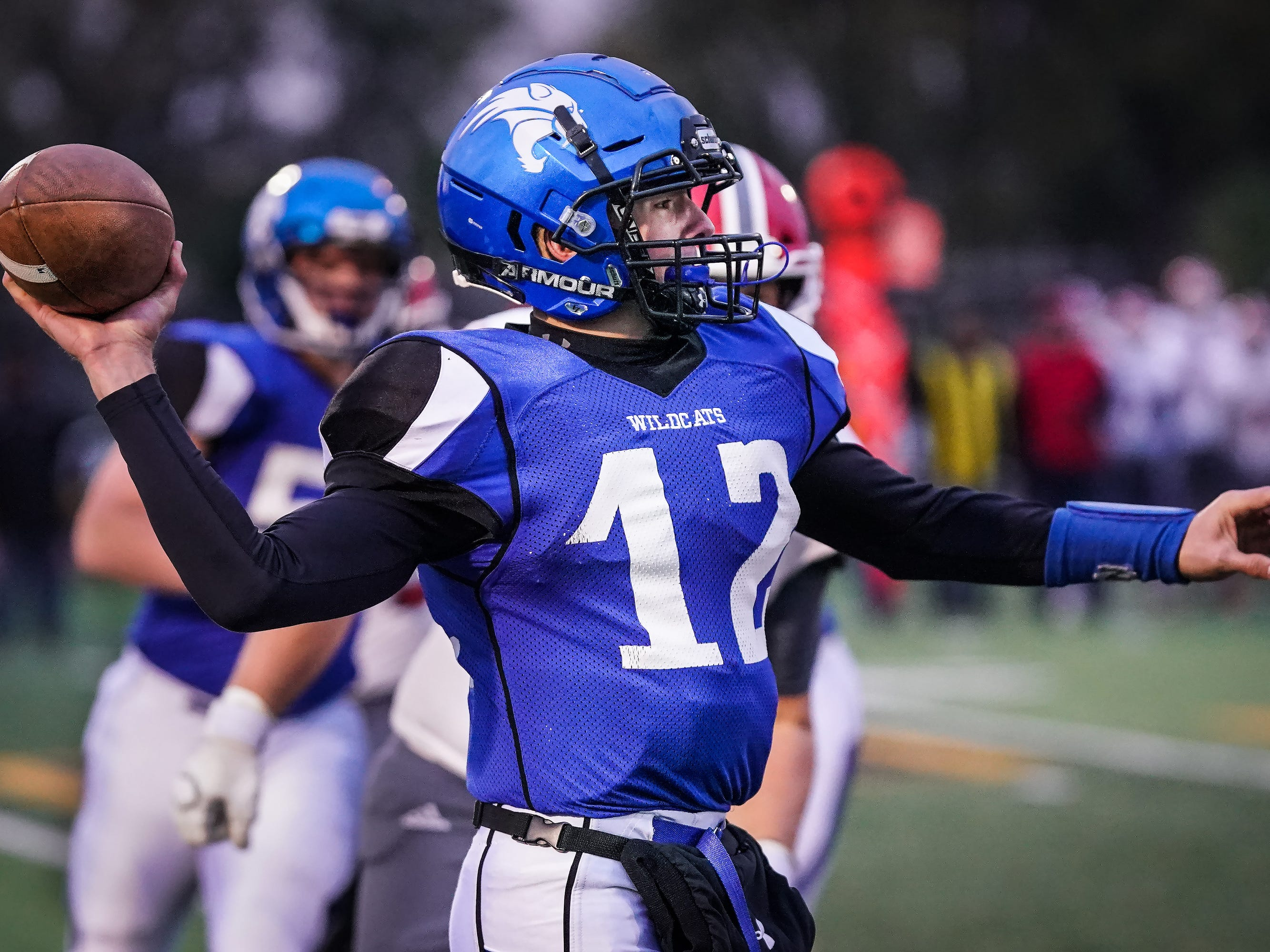 Oshkosh West quarterback Jake Ketter (12) drops back to pass. The Oshkosh West Wildcats hosted the Neenah Rockets in an FVA-South conference matchup Friday evening, October 12, 2018 at J. J. Keller Field at Titan Stadium.