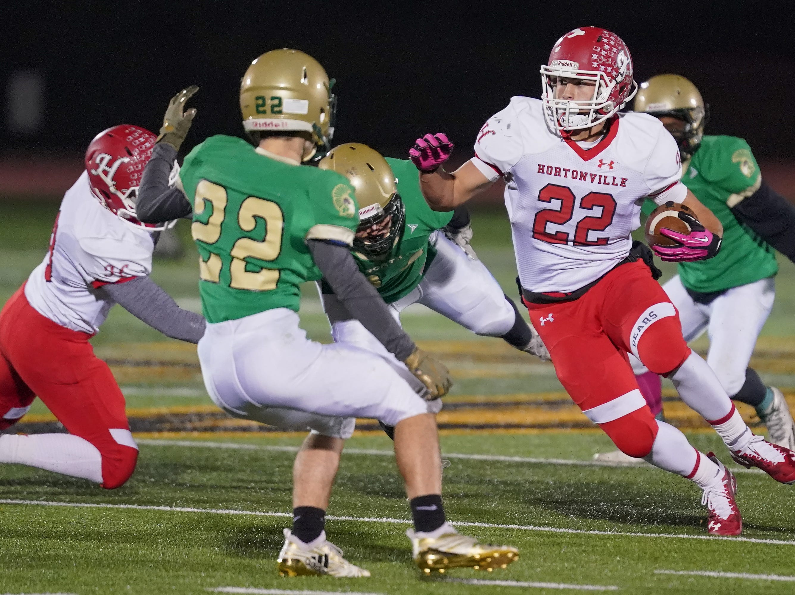 Jose Concepcion (22) of Hortonville looks for running room in the first half. The Oshkosh North Spartans hosted the Hortonville Polar Bears in an FVA-South conference matchup Friday evening, October 12, 2018 at J. J. Keller Field at Titan Stadium.