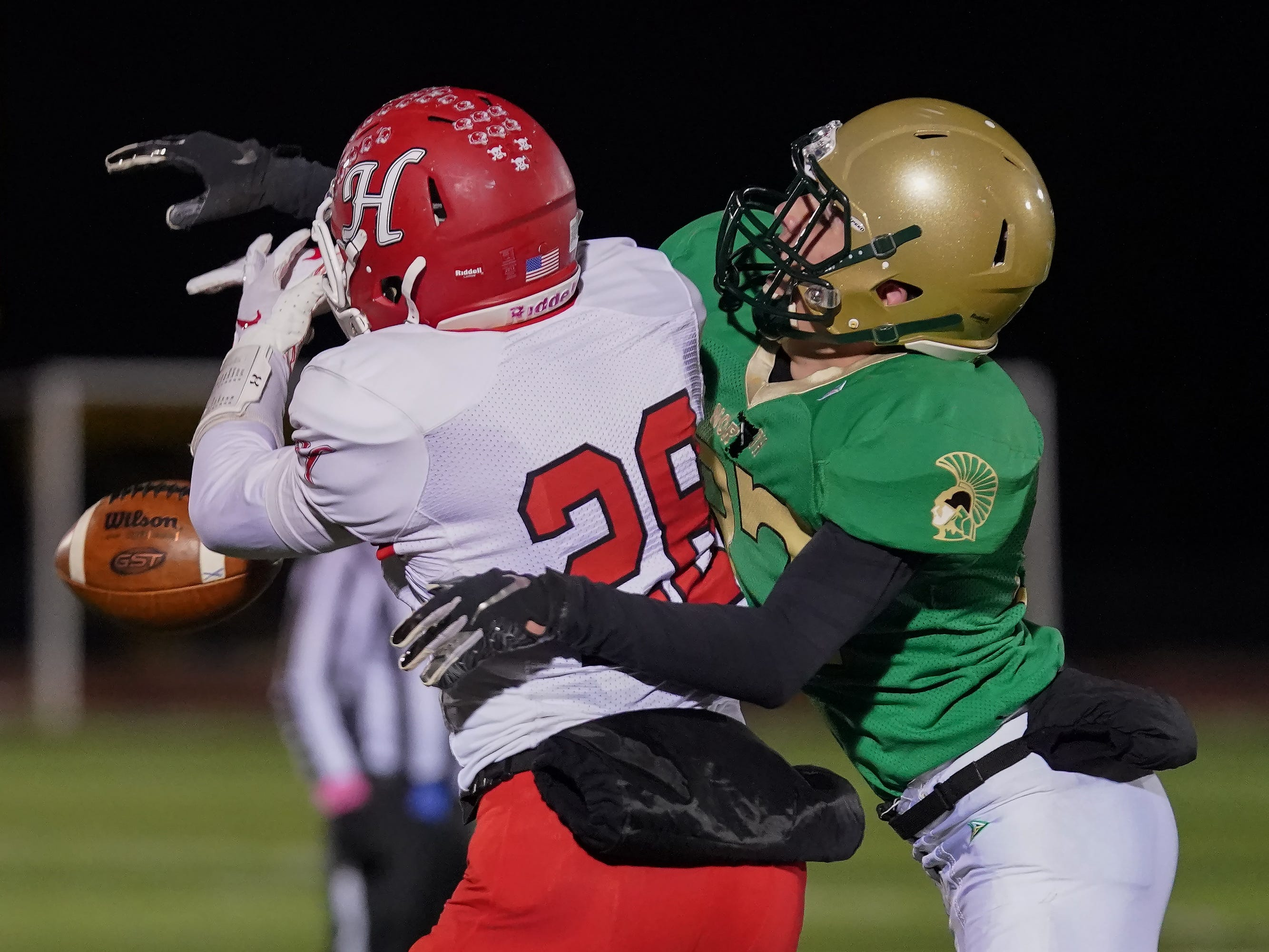 Gage Payne (28) of Hortonville can't hang on to a pass. The Oshkosh North Spartans hosted the Hortonville Polar Bears in an FVA-South conference matchup Friday evening, October 12, 2018 at J. J. Keller Field at Titan Stadium.