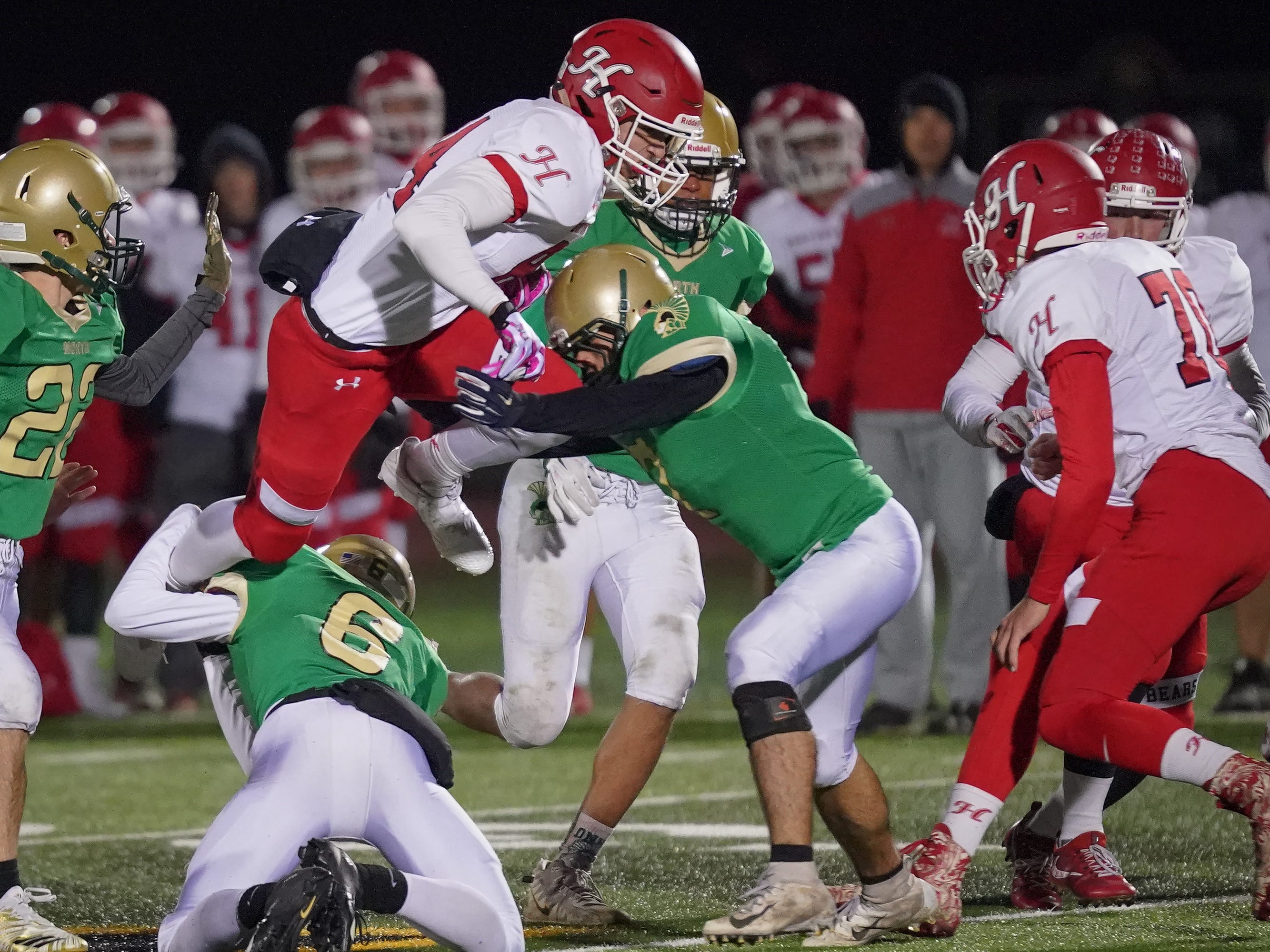 Josh Giese (84) of Hortonville goes up and over the pile for a gain. The Oshkosh North Spartans hosted the Hortonville Polar Bears in an FVA-South conference matchup Friday evening, October 12, 2018 at J. J. Keller Field at Titan Stadium.