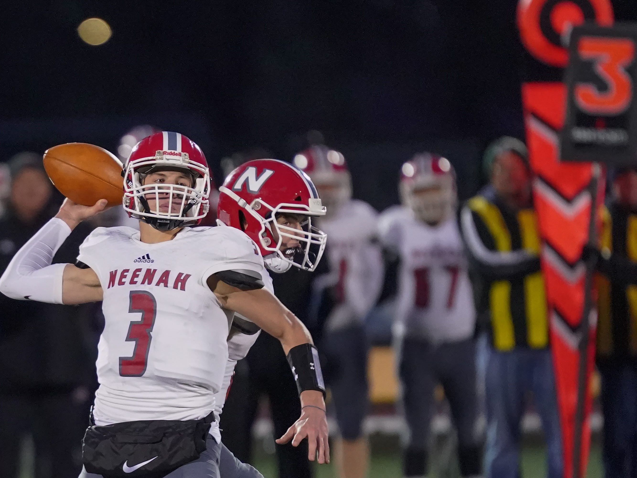 Neenah quarterback Sam Dietrich (3) drops back to pass. The Oshkosh West Wildcats hosted the Neenah Rockets in an FVA-South conference matchup Friday evening, October 12, 2018 at J. J. Keller Field at Titan Stadium.