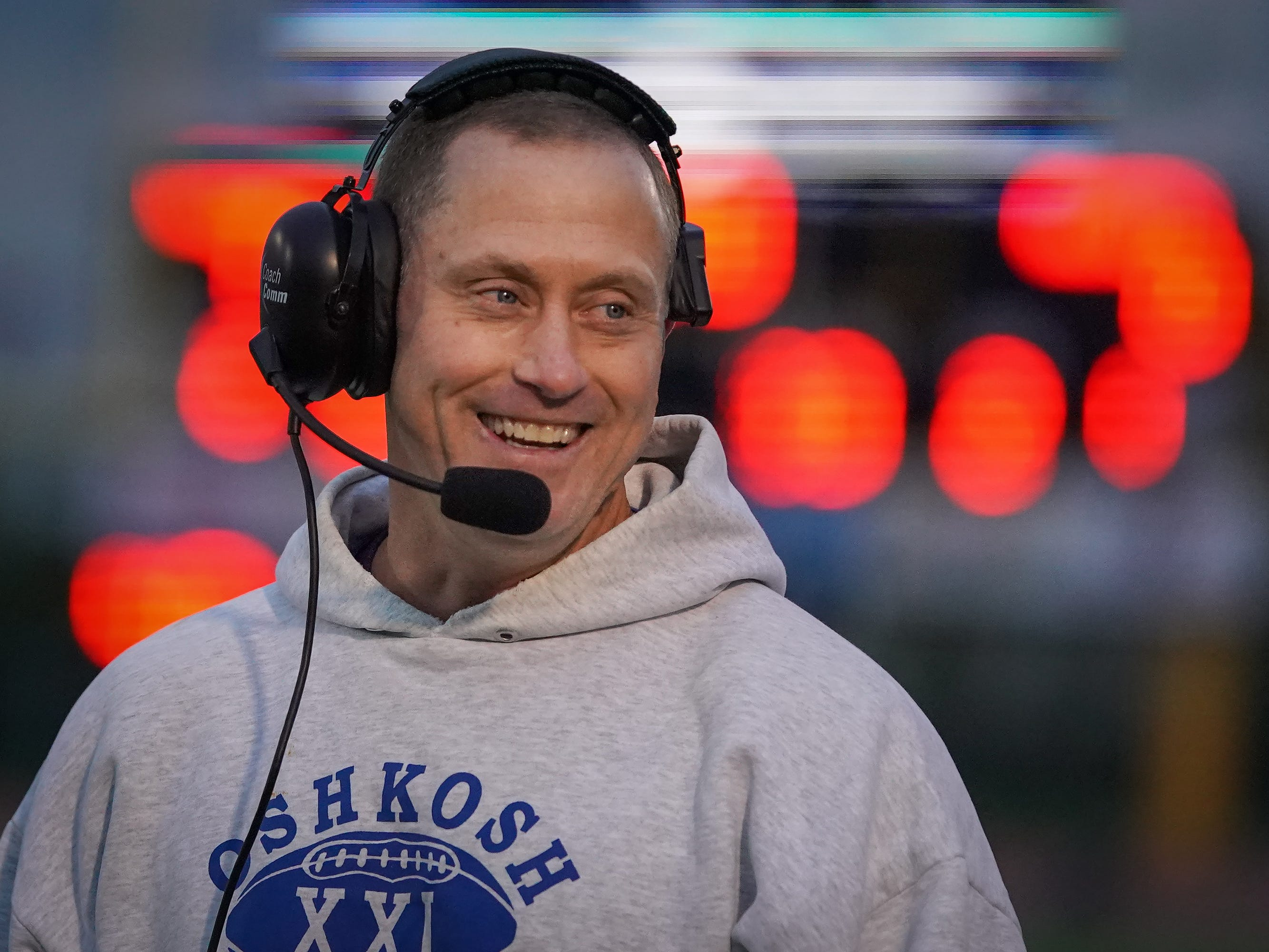 Oshkosh West head coach Ken Levine smiles after the Wildcats score a touchdown. The Oshkosh West Wildcats hosted the Neenah Rockets in an FVA-South conference matchup Friday evening, October 12, 2018 at J. J. Keller Field at Titan Stadium.