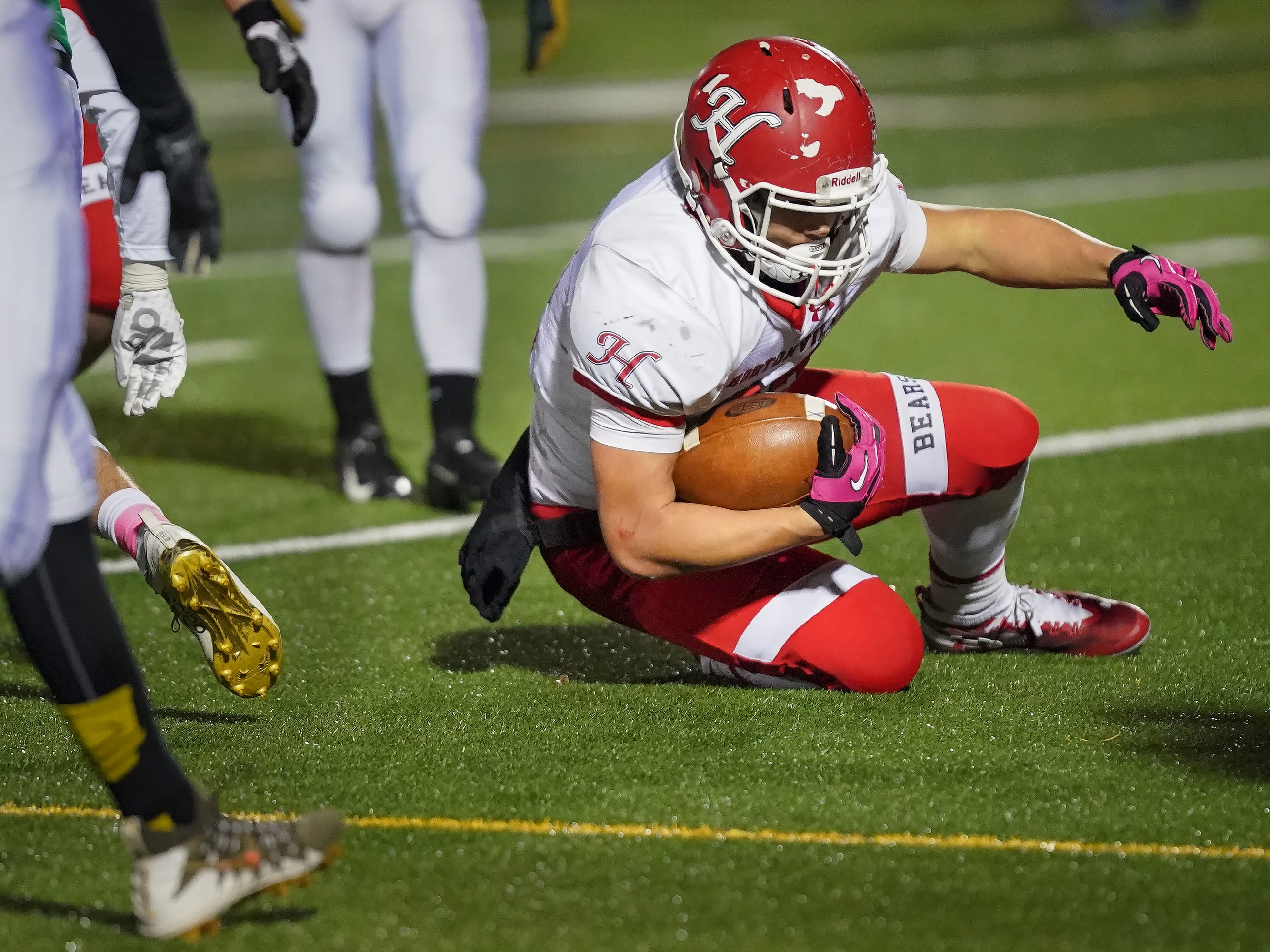 Jose Concepcion (22) of Hortonville breaks through the line for a touchdown. The Oshkosh North Spartans hosted the Hortonville Polar Bears in an FVA-South conference matchup Friday evening, October 12, 2018 at J. J. Keller Field at Titan Stadium.