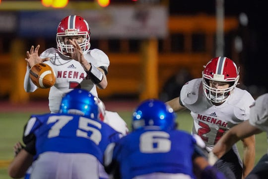 Neenah quarterback Sam Dietrich (3) takes the snap in the third quarter. The Oshkosh West Wildcats hosted the Neenah Rockets in an FVA-South conference matchup Friday evening, October 12, 2018 at J. J. Keller Field at Titan Stadium.