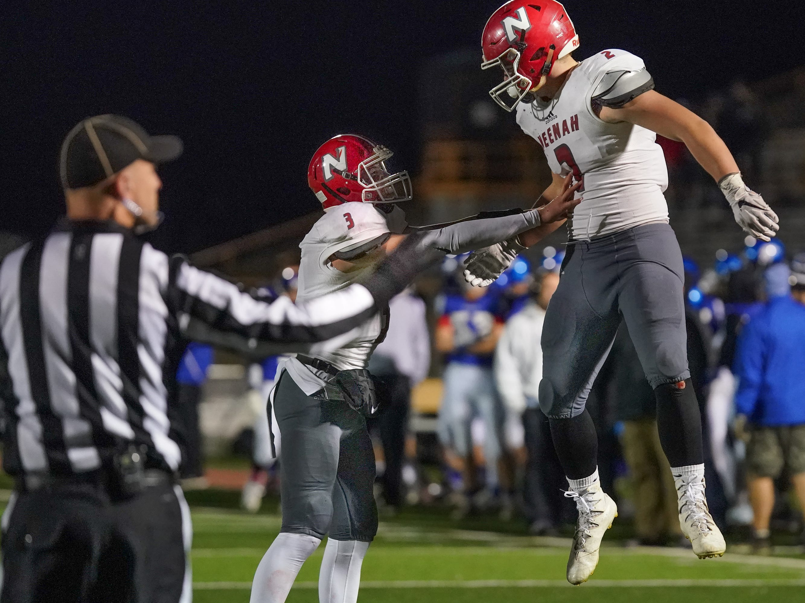 Neenah quarterback Sam Dietrich (3) and Reece Heyerdahl (2) celebrate after a Rocket touchdown. The Oshkosh West Wildcats hosted the Neenah Rockets in an FVA-South conference matchup Friday evening, October 12, 2018 at J. J. Keller Field at Titan Stadium.