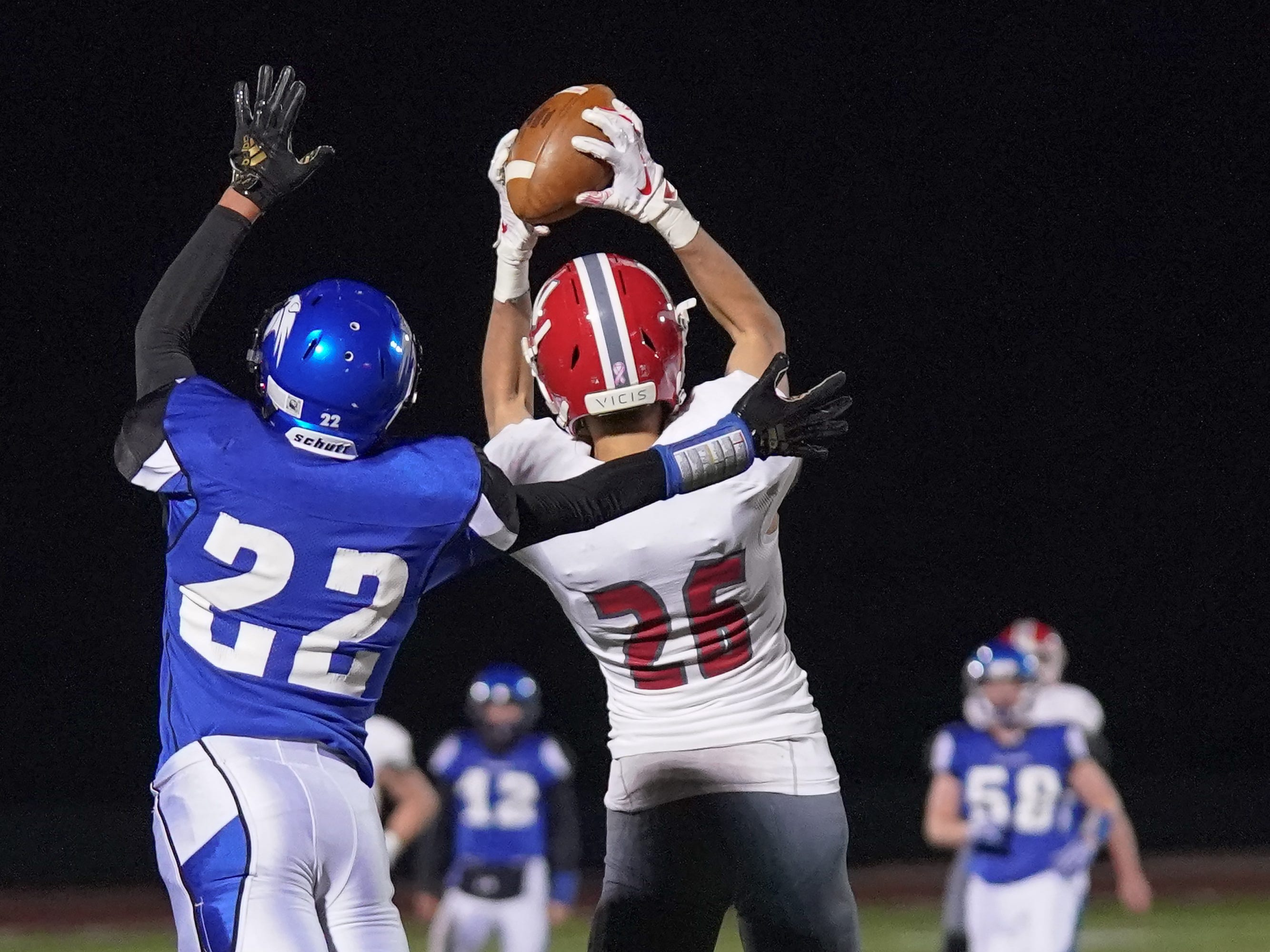 Jack VanDyke (26) of Neenah intercepts an Oshkosh West pass near the end zone in the fourth quarter. The Oshkosh West Wildcats hosted the Neenah Rockets in an FVA-South conference matchup Friday evening, October 12, 2018 at J. J. Keller Field at Titan Stadium.