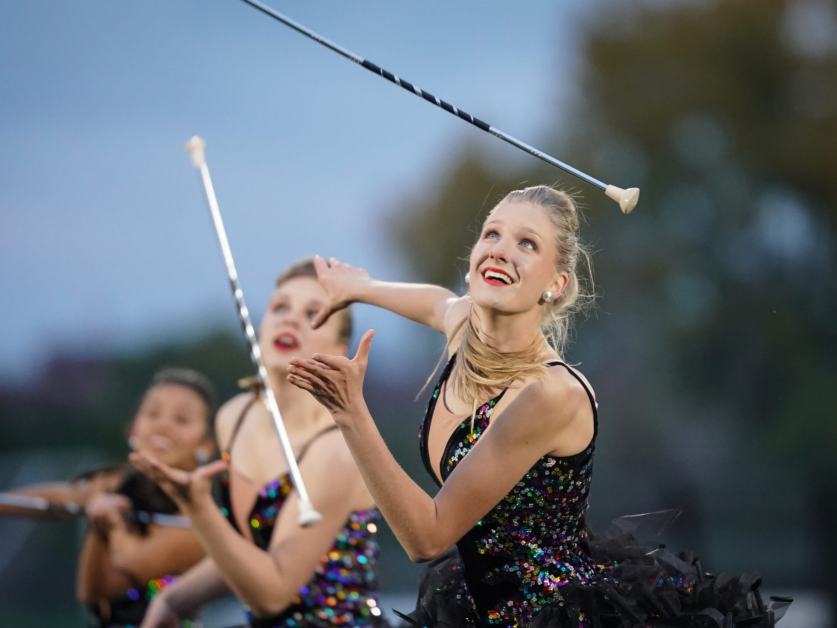 The Oshkosh West twirl team performs at half time. The Oshkosh West Wildcats hosted the Neenah Rockets in an FVA-South conference matchup Friday evening, October 12, 2018 at J. J. Keller Field at Titan Stadium.
