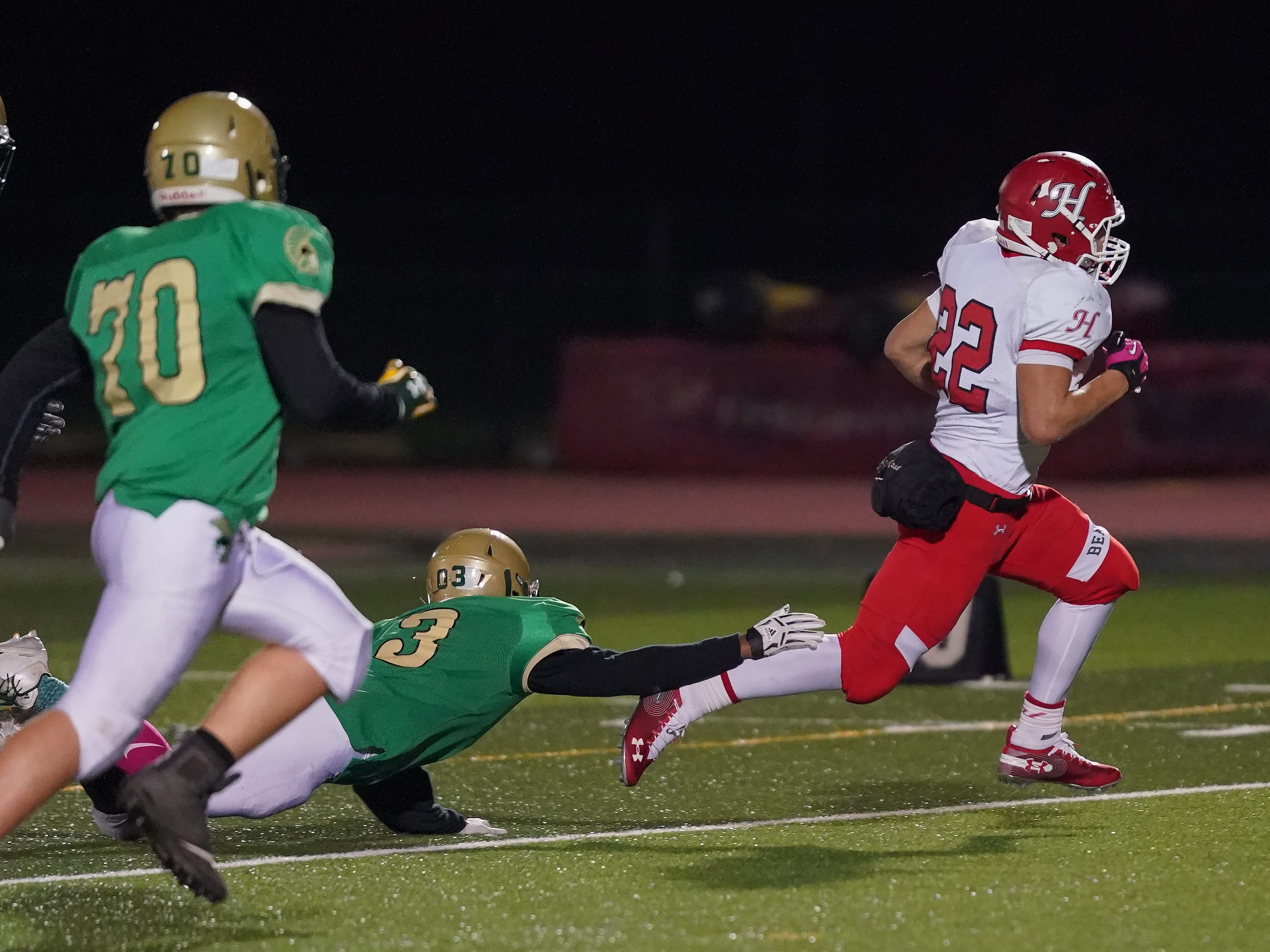 Jose Concepcion (22) of Hortonville breaks free from the Oshkosh North defense to score a touchdown. The Oshkosh North Spartans hosted the Hortonville Polar Bears in an FVA-South conference matchup Friday evening, October 12, 2018 at J. J. Keller Field at Titan Stadium.