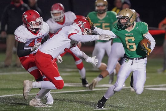 Braden Christie (6) of Oshkosh North stiff arms Ben Buelow (30) of Hortonville during a kickoff return. The Oshkosh North Spartans hosted the Hortonville Polar Bears in an FVA-South conference matchup Friday evening, October 12, 2018 at J. J. Keller Field at Titan Stadium.