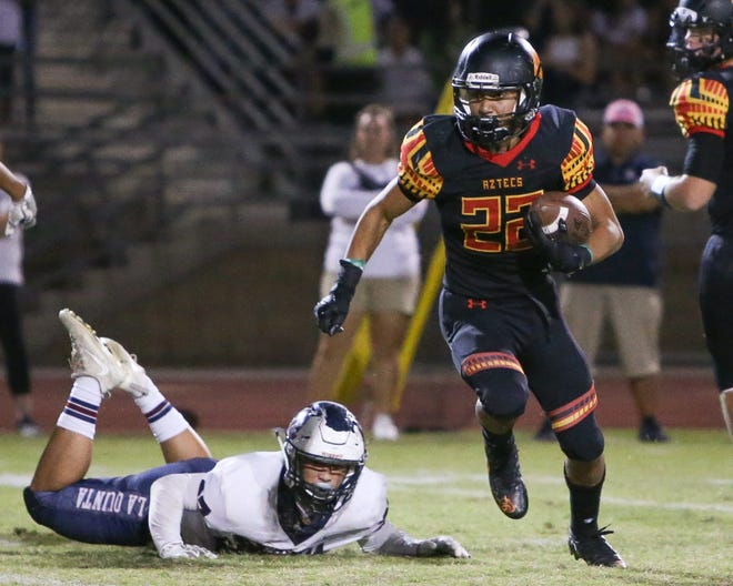 Jordan Garcia with the hand off. The Palm Desert varsity football team won Friday's home conference game against rival school La Quinta by a score of 34-32.