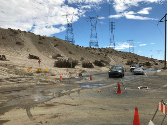 Cars are being diverted off Varner Road at Date Palm Drive in Cathedral City on Saturday due mud and flooding from Friday night's storm. The roadway is expected to remain closed until sometime Monday, Oct. 15, 2018.