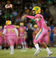 Coachella Valley High School's Donny Fitzgerald looks for the open man against Indio High School at Ed White Stadium on October 12, 2018. Coachella won the game.