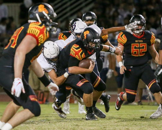 The Palm Desert varsity football team won Friday's home conference game against rival school La Quinta by a score of 34-32.