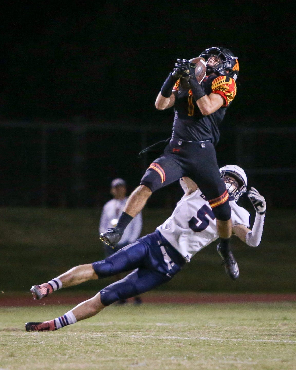 Palm Desert's Jacob McIlroy snags an interception against La Quinta in the Aztecs' 34-32 win.
