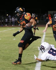 Palm Desert's Jordan Garcia breaks free for a first-half touchdown Friday against La Quinta.