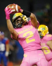 Coachella Valley High School's Sebastian Camarena catches the ball for a gain of yards against Indio High School at Ed White Stadium on October 12, 2018. Coachella won the game.
