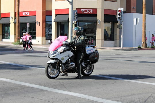 CHP and police officers were among the participants of the Paint El Paseo Pink walk in Palm Desert.
