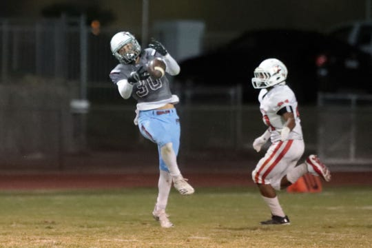 Rancho Mirage's Mario Montalvo almost intercepts a Palm Springs pass on Friday, October 12, 2018 in Palm Springs.