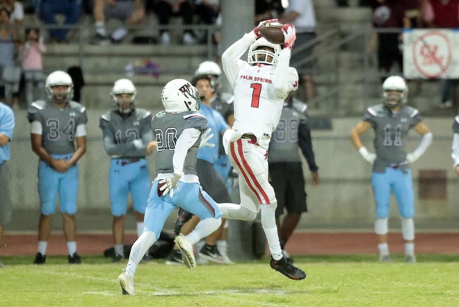 Palm Springs' Damion Loman completes a pass to him for a first down against Rancho Mirage on Friday, October 12, 2018 in Palm Springs.