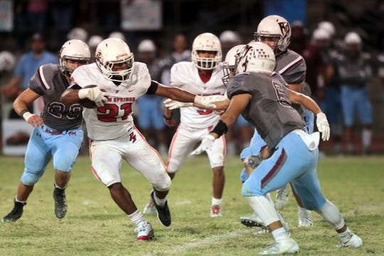 Palm Springs' Kelton Johnson carries the ball for a gain against Rancho Mirage on Friday, October 12, 2018 in Palm Springs.