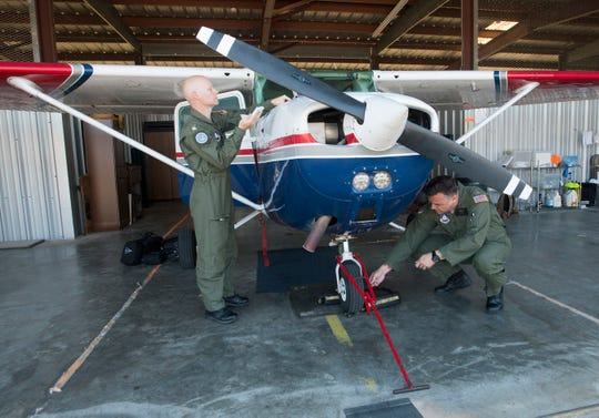 Pilots with the Civil Air Patrol prepare to fly out of Pensacola on Saturday to survey the damage over Panama City and Mexico Beach in the wake of Hurricane Michael.