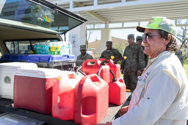 Hurricane Michael survivors lined up outside a National Guard distribution point at 1900 Michigan Ave., Panama City, to receive water and canned foods on Saturday, Oct. 13, 2018.