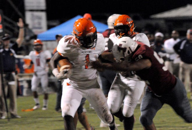 Escambia running back Frank Peasant rumbles through the Tate defense for a touchdown on Friday night at Tate High.