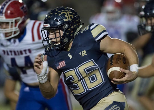 Tyler Dittmer (36) carries the ball during the Pace vs Gulf Breeze football game at Gulf Breeze High School on Friday, October 12, 2018.