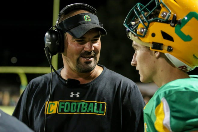 Pensacola Catholic head coach Matt Adams chats with quarterback Colin Whibbs during the game against Northview at Catholic High School on Friday, October 12, 2018.
