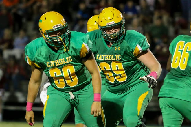 Pensacola Catholic offensive linemen Ryan Gay (60) and Robert Parker (69) watch as the play unfolds past the line of scrimmage against Northview in the homecoming game at Catholic High School on Friday, October 12, 2018.