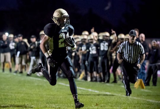 Delone Catholic's Mason Clabaugh runs into the end zone to score a touchdown against Fairfield on Friday, October 12, 2018. The Squires won 57-3.