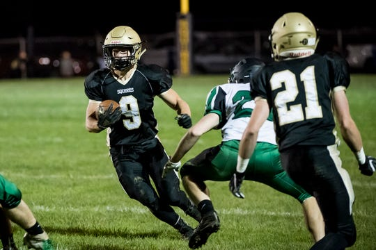 Delone Catholic's Logan Brown runs the ball against Fairfield on Friday, October 12, 2018. The Squires won 57-3.