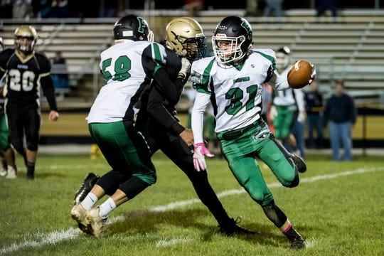 Fairfield's Nic Wheeler runs with the ball during a reverse play against Delone Catholic on Friday, October 12, 2018. The Knights fell 57-3.