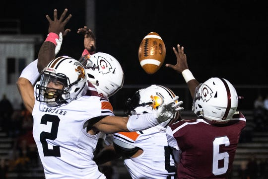 A cluster of players including York Suburban's Savion Harrison (2) and Gettysburg's William Warren (6) attempt and fail to catch the ball during a football game between Gettysburg and York Suburban, Friday, Oct. 12, 2018, in Gettysburg. Gettysburg led York Suburban 33-0 at the half.