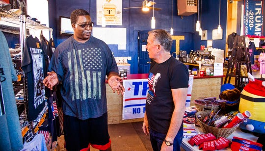 Herbert Clark, 63, left, speaks with Steve Slaton, right, a co-owner  of The Trumped Store and Coffee House in Show Low, Arizona.  The store sells all things Trump, Friday, September 28, 2018. Clark is a President Donald Trump supporter.