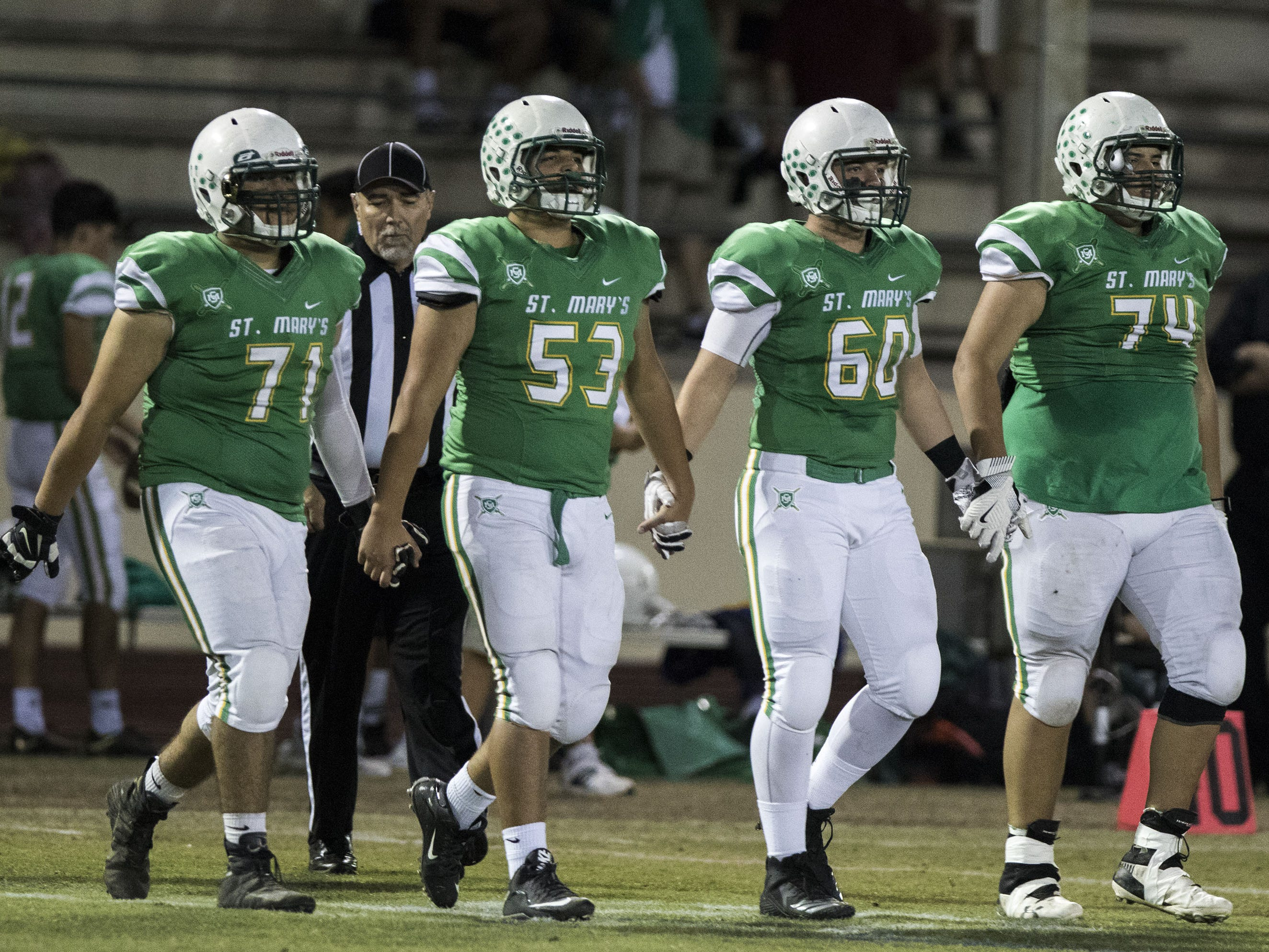St. Mary's captains (left to right) Manny Valencia, Noah Martinez, Drew Neighbors and Andrew Carreon walk to the coin toss during their game against Greenway at Phoenix College in Phoenix Friday, Oct. 12, 2018. #azhsfb