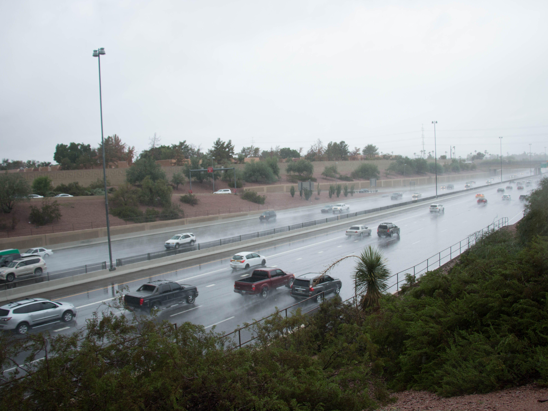 Rain on the I-10 caused traffic slowed traffic.