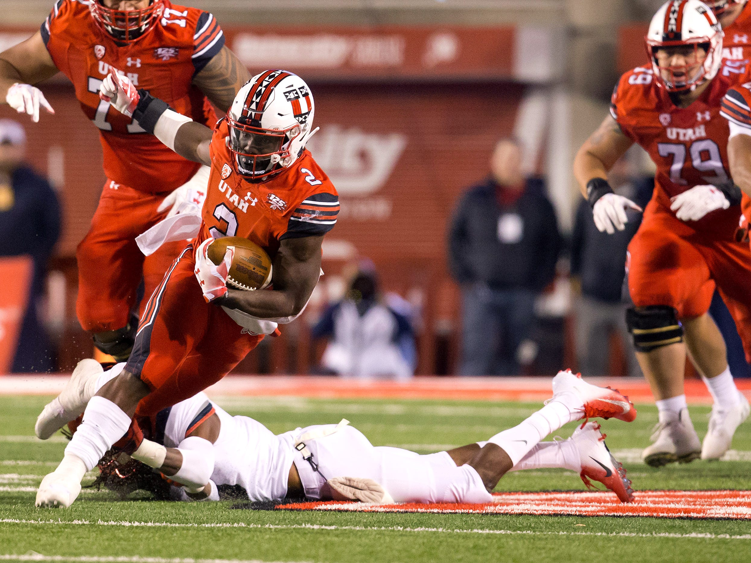 Oct 12, 2018; Salt Lake City, UT, USA; Utah Utes running back Zack Moss (2) attempts to break free of the grasp of Arizona Wildcats safety Jarrius Wallace (3) during the first half at Rice-Eccles Stadium.