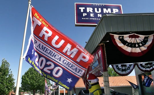 Karen MacKean and Steve Slaton are co-owners of The Trumped Store and Coffee House in Show Low, Arizona.  The outside of the store is decorated with Trump flags and patriotic bunting, Friday, September 28, 2018.
