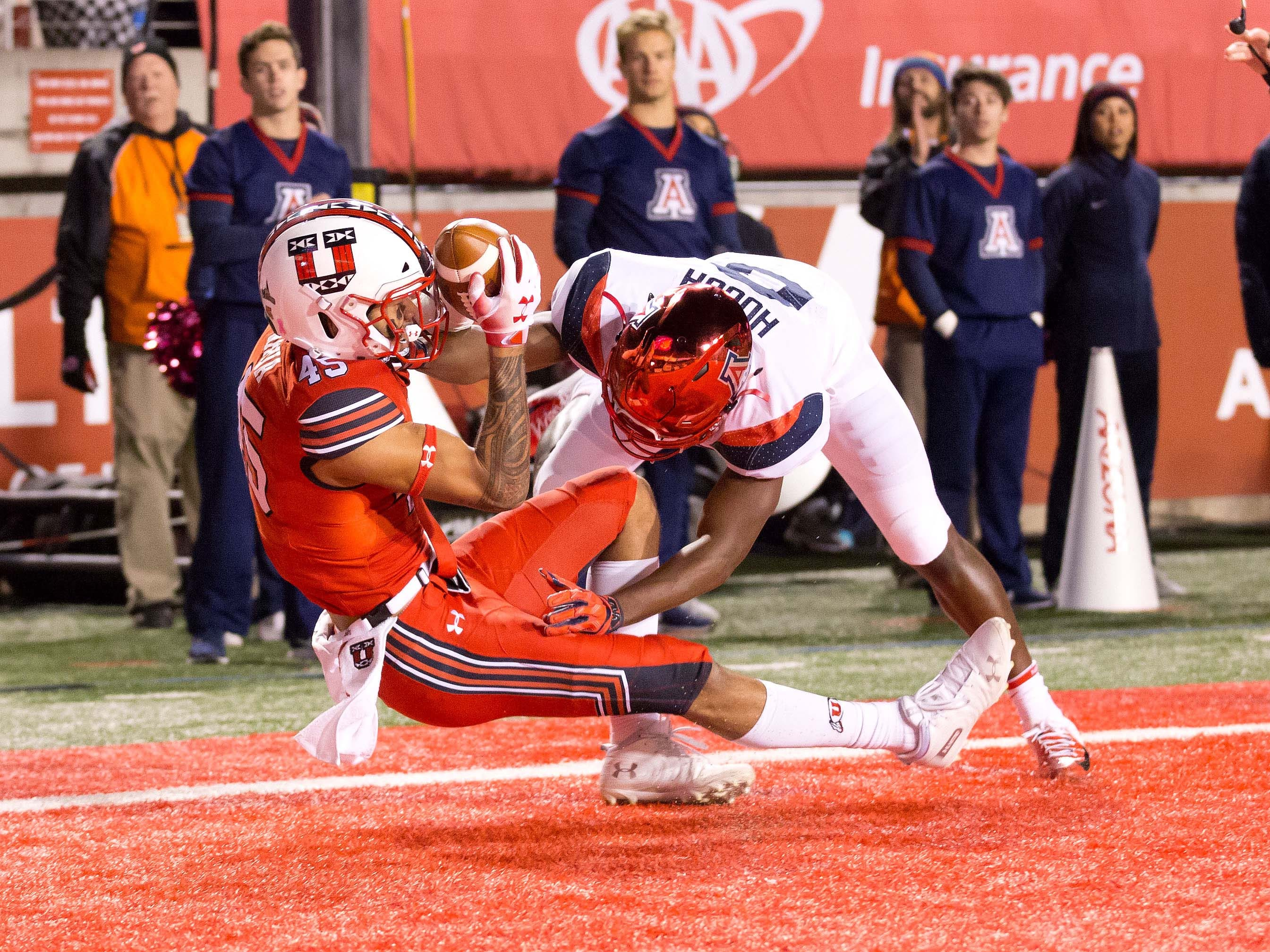 Oct 12, 2018; Salt Lake City, UT, USA; Utah Utes wide receiver Samson Nacua (45) catches a touchdown pass against Arizona Wildcats cornerback Tim Hough (8) during the first quarter at Rice-Eccles Stadium.