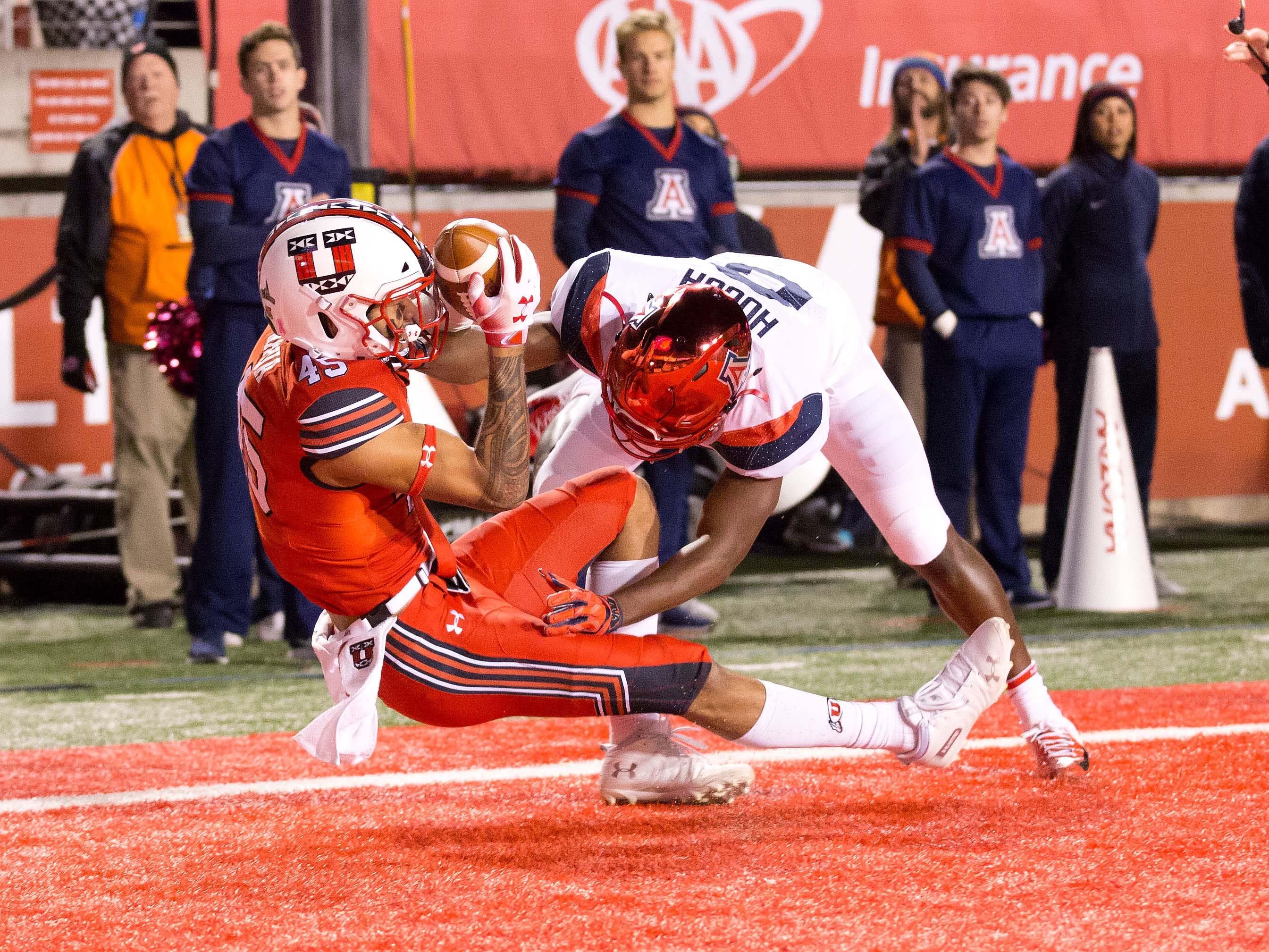 Oct 12, 2018; Salt Lake City, UT, USA; Utah Utes wide receiver Samson Nacua (45) catches a touchdown pass against Arizona Wildcats cornerback Tim Hough (8) during the first quarter at Rice-Eccles Stadium.