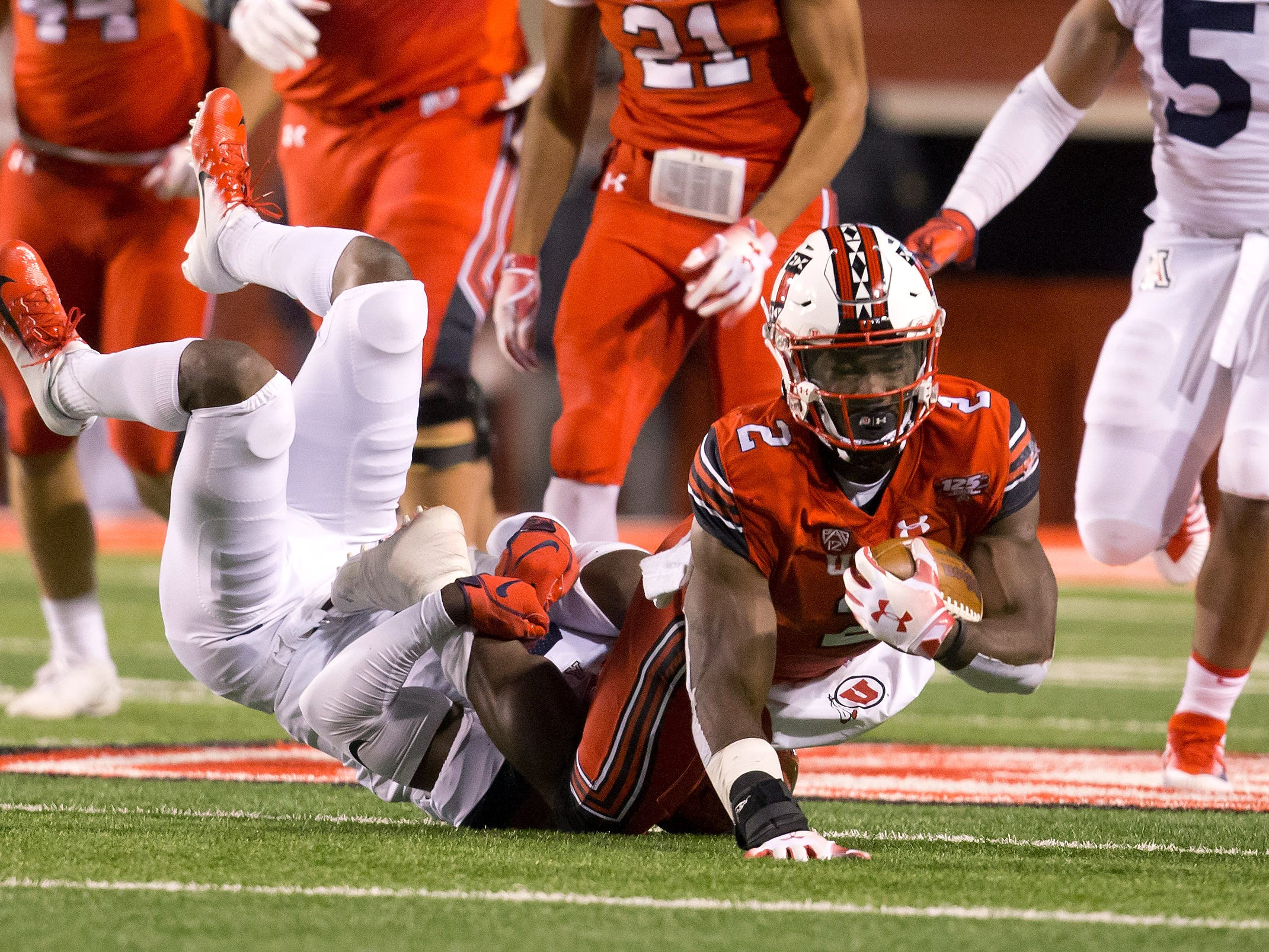 Oct 12, 2018; Salt Lake City, UT, USA; Utah Utes running back Zack Moss (2) is tackled by Arizona Wildcats safety Demetrius Flannigan-Fowles (6) during the first half at Rice-Eccles Stadium.