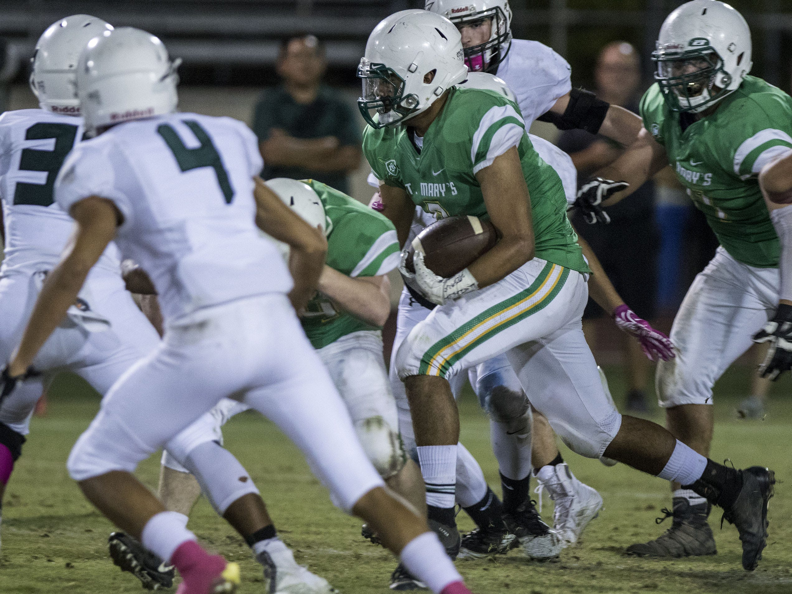 St. Mary's Jessie Parada-Gonzalez runs up the middle against Greenway during their game at Phoenix College in Phoenix Friday, Oct. 12, 2018. #azhsfb